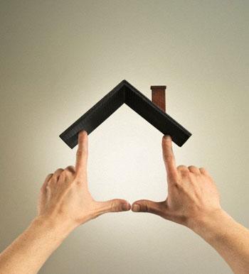 Hands making house shape