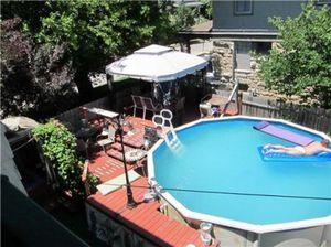 swimmer-in-backyard-pool-bad-mls-photo-real-estate-fail
