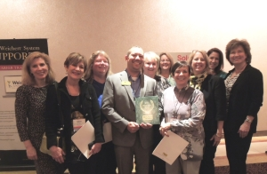 Broker/Owner John Lawrence and members of the sales team with the 2014 Model Office Award.