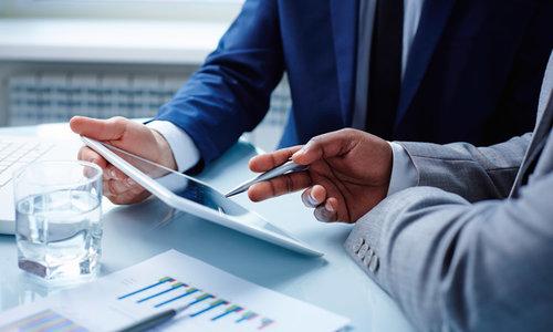 businessmen-meeting-tablet-tech-managing-broker-real-estate