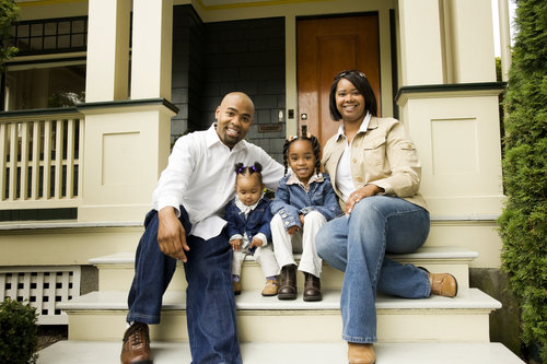 family-front-steps-house-porch-home-buyers-sellers