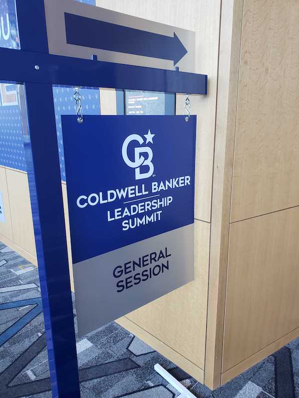 Coldwell Banker sign directing attendees to the general session utilizes the new Project North Star branding