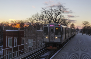Loop-bound Pink Line pulling into the Kedzie station in Chicago's North Lawndale neighborhood.