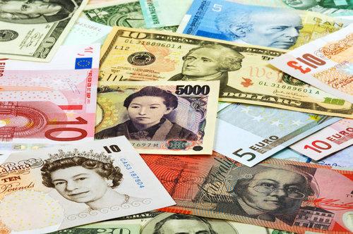 Different currencies organized as a background