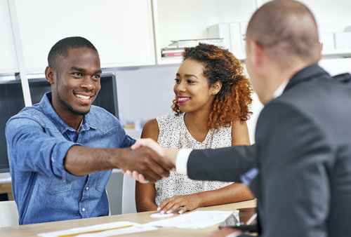mortgage-loan-officer-couple-shaking-hands