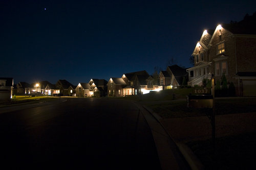 homes-houses-at-night-suburb-town-community-real-estate