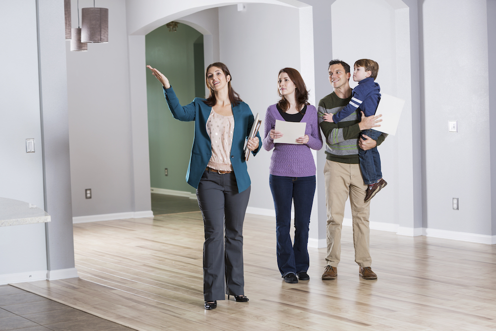 Young family with real estate agent at an open house.