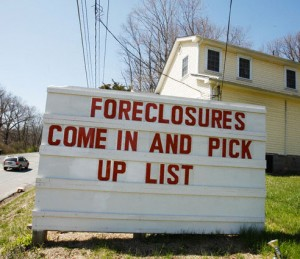 A Realtor advertises houses for sale due to foreclosure in Stroudsburg, Pa.