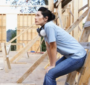 Woman Resting on Construction Site