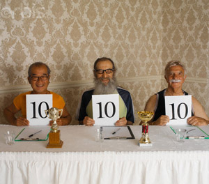 Three Smiling Judges Holding up Perfect Ten