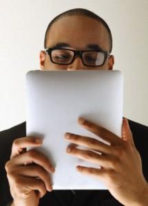 Man looking at tablet computer