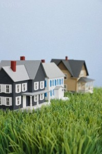 Close up of model houses on fake grass